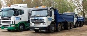 Three trucks in yard