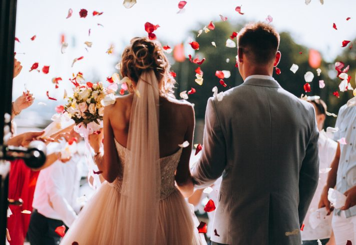 Rose petals all over a newly wedded couple.