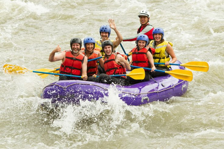 A white family on a vacation rafting together.