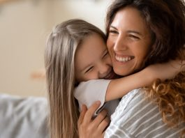 A young girl hugging her mother