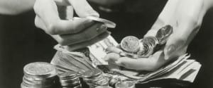 Woman counting change, close up of hands