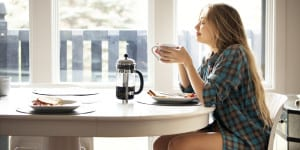 Young Woman Enjoying Coffee And Breakfast stress
