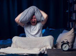 Man screaming because he can't sleep