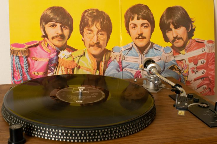 """The Beatles """"Sgt Pepper's Lonely Hearts Club Band"""" being played on a vinyl record"""