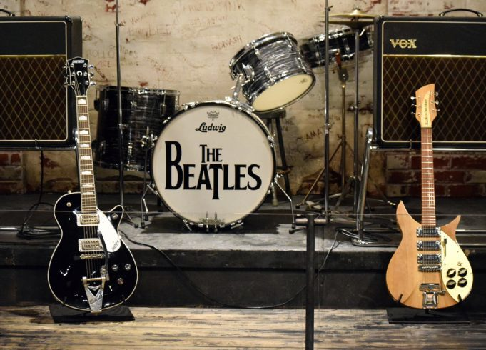 """A drum stage with """"The Beatles"""" written on it"""