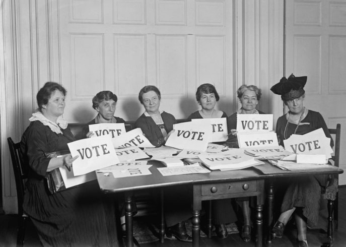 Women holding vote cards