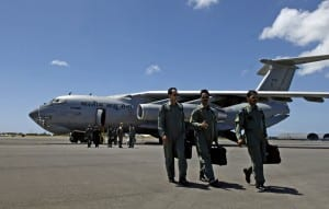 Indian air force pilots walk away from their IL-76 medium cargo jet after landing at Hickam Air Force Base, Hawaii, Sept. 20. The Indian crew flew Airmen from the 15th Airlift Wing on a training mission to show the capabilities of their aircraft to their American counterparts. (U.S. Air Force photo/Tech. Sgt. Shane A. Cuomo)