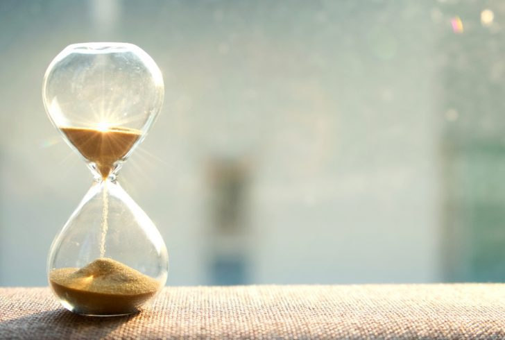 An hourglass against a sunny background