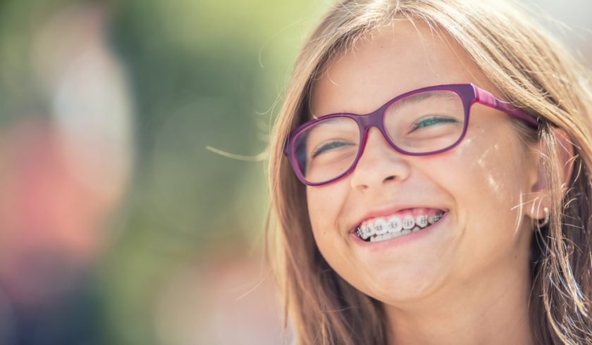 Smiling young girl with braces