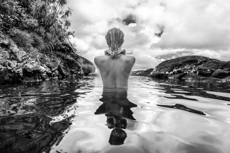 Naked woman in water