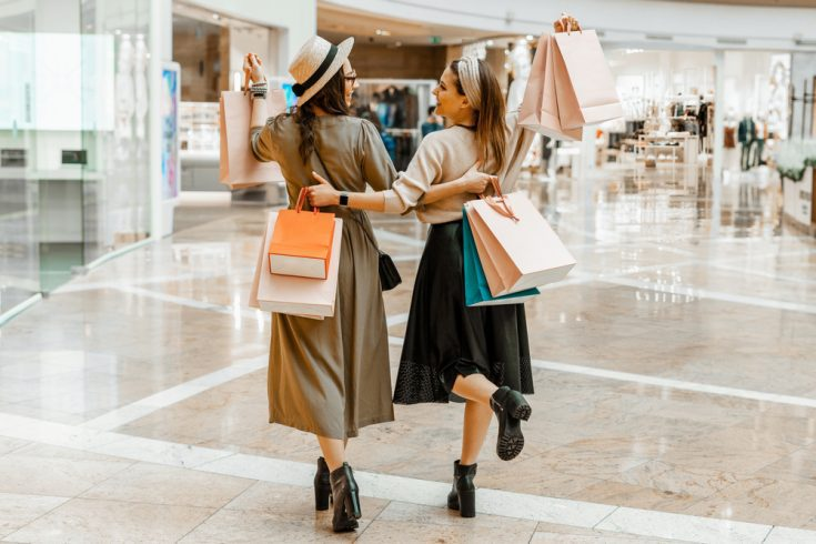 Friends in a mall shopping together