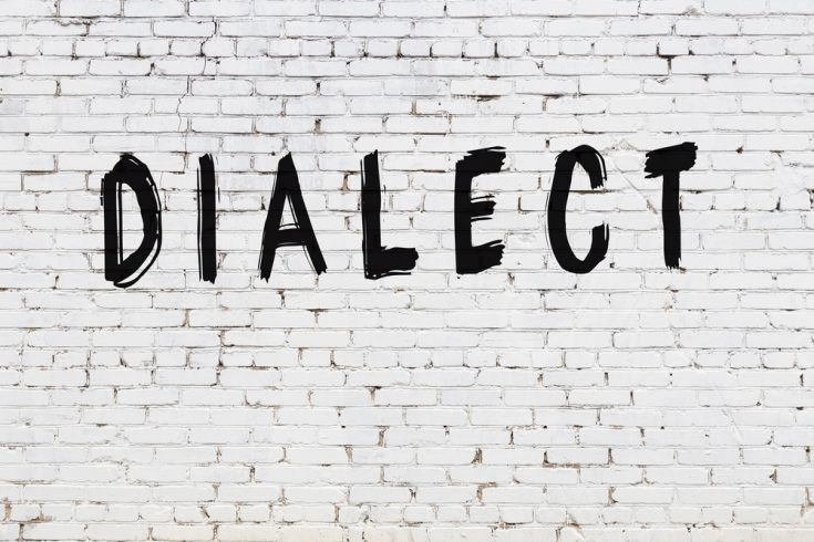 Dialect written on a white wall