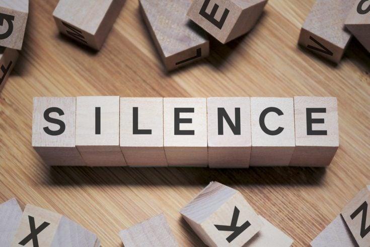 Silence written with wooden blocks