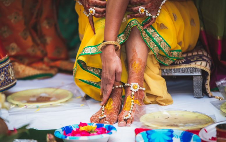 Bride putting ubtan on her feet