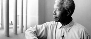 Nelson-Mandela-revisits-prison-cell-on-Robben-Island640px