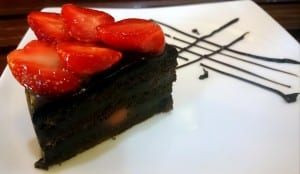 Chocolate cake topped with fresh strawberries