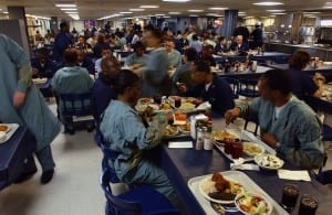1280px-US_Navy_030425-N-6967M-203_Crew_members_take_time_to_get_a_bite_to_eat_on_the_mess_decks_of_the_USNS_Comfort_(T-AH_20) hostel life