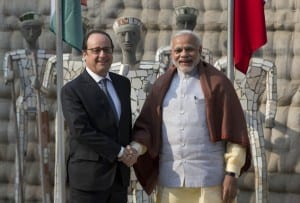 Indian Prime Minister Narendra Modi, right and French President Francois Hollande pose for the media at the Rock Garden in Chandigarh, India, Sunday, Jan. 24, 2016. Hollande began a three-day visit to India on Sunday that could push a multibillion-dollar deal for combat airplanes and closer cooperation on counterterrorism and clean energy. (AP Photo/Manish Swarup)