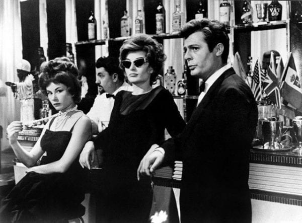 The many seductions- the lavish parties and the heiress, troubled by a doomed boredom who seduces him. la dolce vita