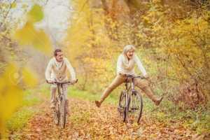 33934870-active-seniors-ridding-bike-in-autumn-nature-they-having-fun-outdoor-stock-photo