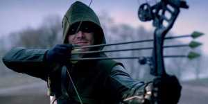 green-arrow-shooting-three-arrows-at-once