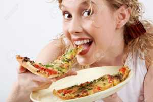 6700321-Image-of-happy-girl-eating-pizza-and-looking-at-camera-Stock-Photo pizza