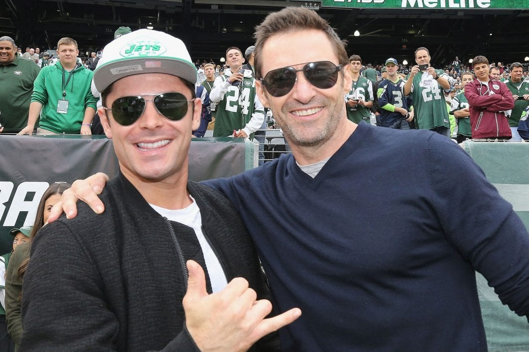 EAST RUTHERFORD, NEW JERSEY - OCTOBER 02: Zach Efron and Hugh Jackman strike a pose when they attend the New York Jets versus Seattle Seahawks game at MetLife Stadium on October 2, 2016 in East Rutherford, New Jersey. (Photo by Al Pereira/WireImage)