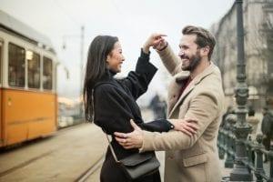 a-happy-couple-dancing-on-sidewalk-3775545