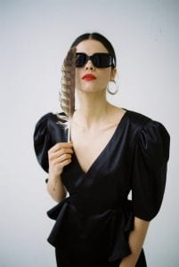 fashionable-woman-in-trendy-outfit-with-sunglasses-4348322