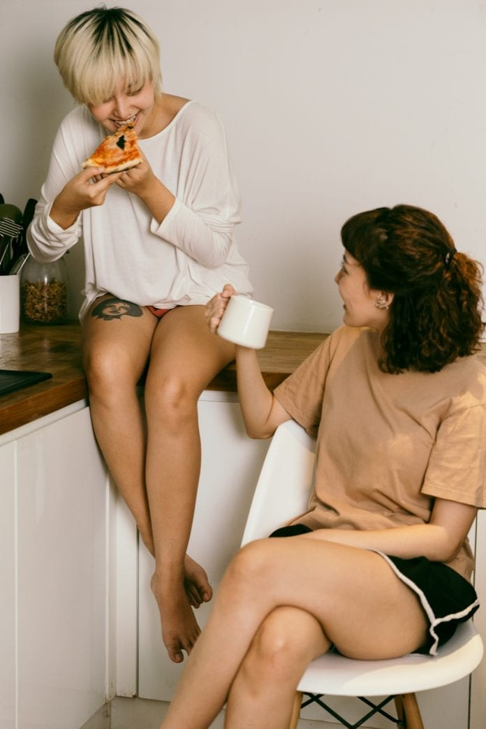 women eating on the kitchen counter