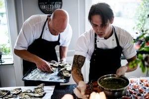 two-men-preparing-food-3217156