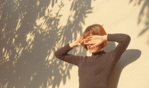 girl standing in the sun