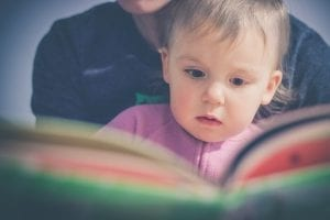 Baby Reading With Parent