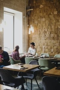 couple-resting-in-creative-restaurant-in-daytime-3951669