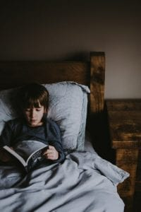 Kid Reading in Bed