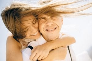 photo-of-woman-hugging-her-man-while-smiling-4693218