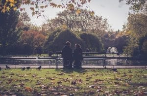 photography-of-people-sitting-on-bench-797888