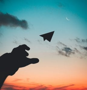 silhouette-photo-of-man-throw-paper-plane-1262304