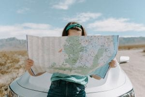 woman-looking-at-the-map-3935702