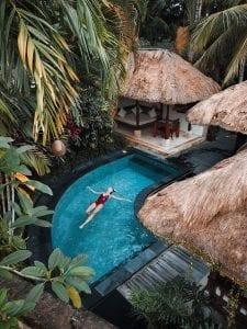 woman-soaking-on-the-swimming-pool-3225531