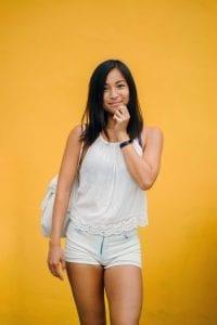 woman-wearing-white-sleeveless-shirt-and-white-denim-shorts-1082962