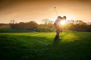 Golfer in golf field