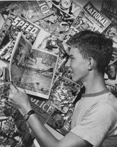 a boy reading comics