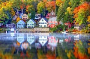 Beautiful reflection of Autumn fall in the Lake Winnipesauke