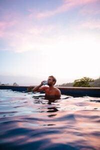A guy enjoying drinks while a refreshing bath