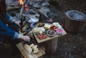 A girl cooking food while camping