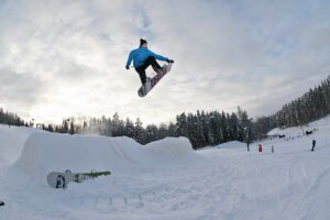 making a jump while snowboarding