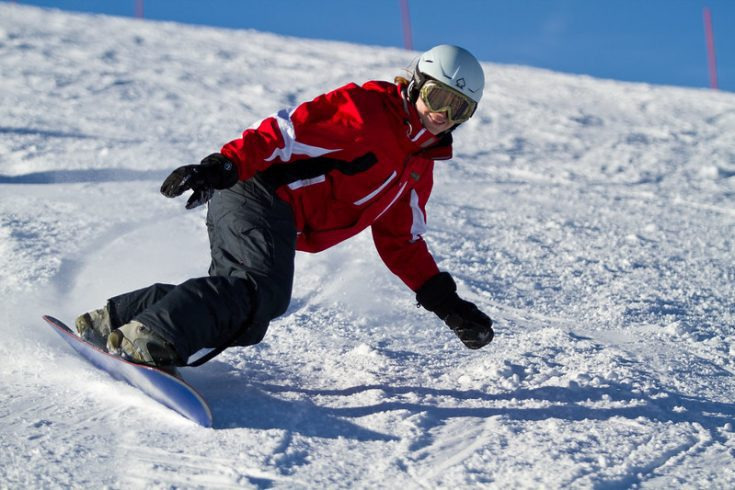 a beginner snowboarding in Mammoth Mountain, California, USA