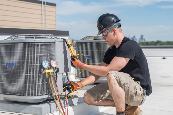 HVAC repairman in action