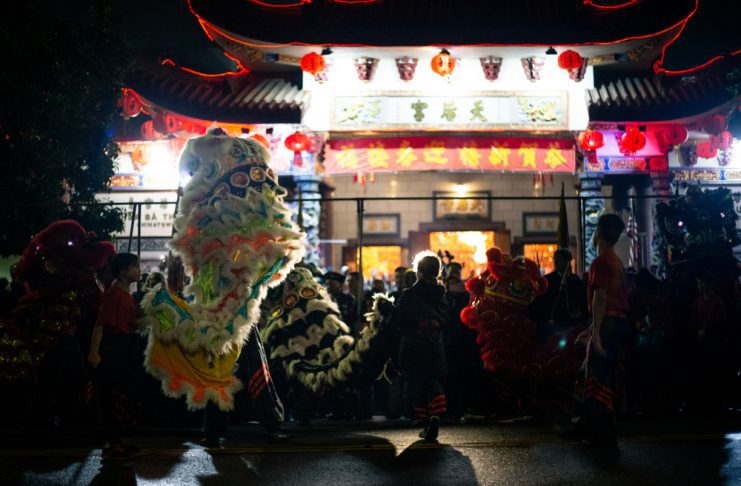 ion Dance in front of the Thein Hau Temple at midnight of Lunar New Year 2019. The outdoor celebration happened during the rain.
